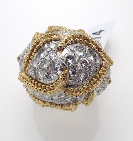 A diamond and eighteen karat bicolor gold ring