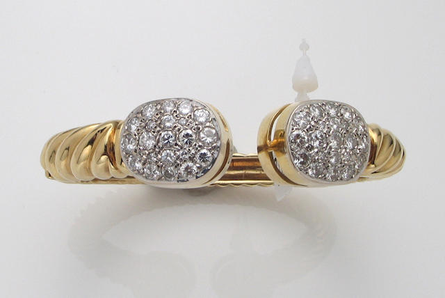 A diamond and eighteen karat gold bangle