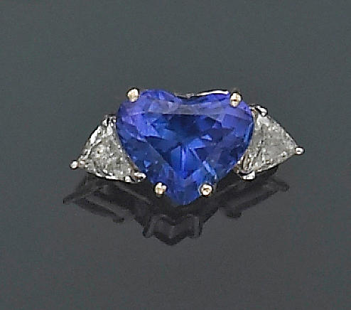 A tanzanite, diamond and eighteen karat gold ring