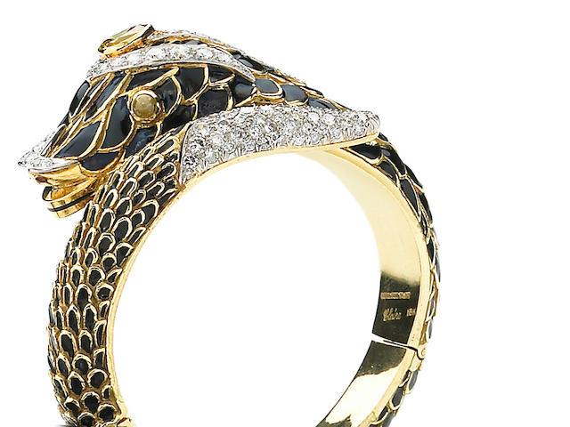 A colored diamond, diamond, cat's eye chrysoberyl, enamel, platinum and eighteen karat bracelet