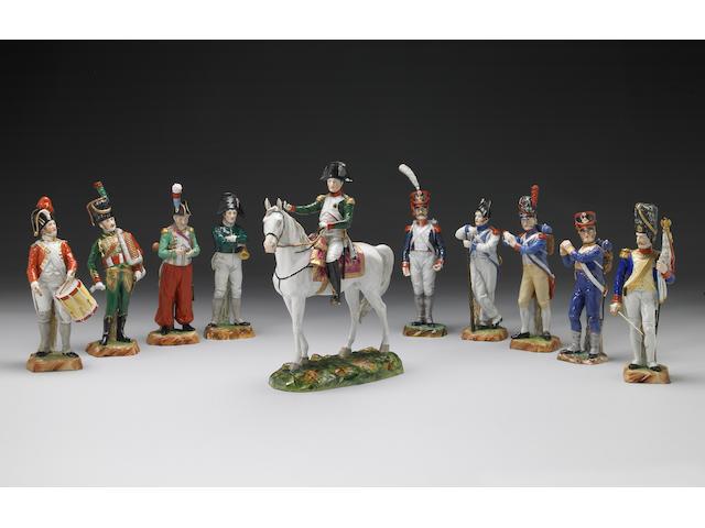 A group of ten porcelain figures, one modelled as Napoleon on horseback
