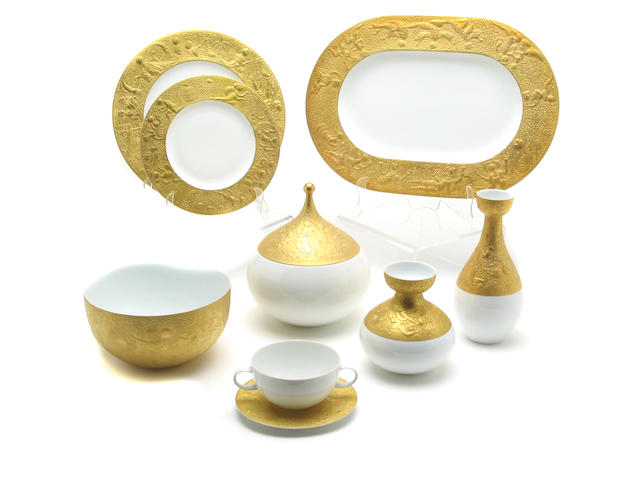 A Rosenthal gilt decorated porcelain part dinnerware service by Bjorn Winblad in the Magic Flute pattern