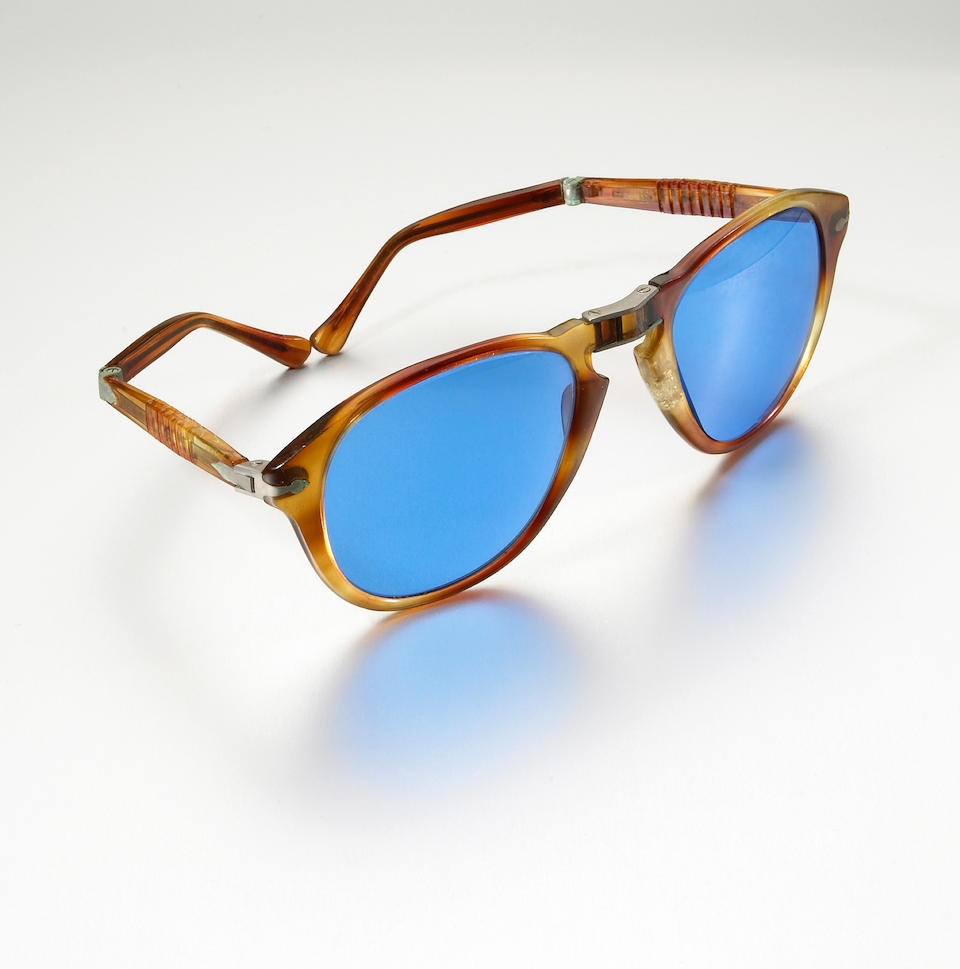 A pair of Persol sunglasses