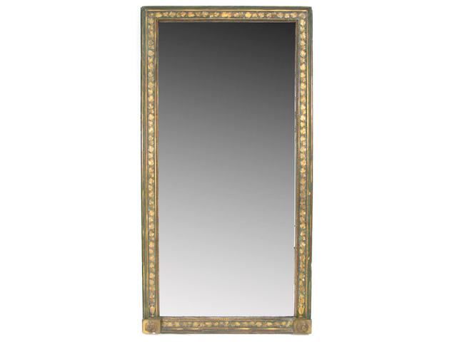 A Louis XVI style carved wood and gesso parcel gilt mirror