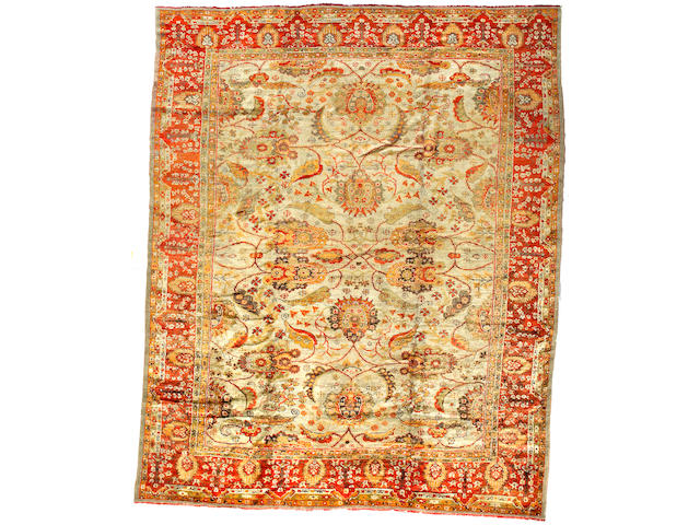 An Oushak carpet West Anatolia size approximately 12ft x 14ft 7in