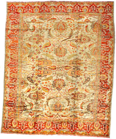 An Oushak carpet West Anatolia size approximately 12ft x 14ft 7in