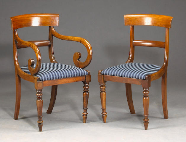 An assembled set of twelve George IV mahogany dining chairs, comprising two armchairs and ten side chairs