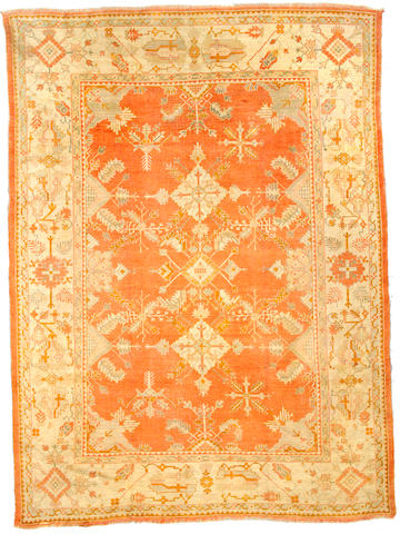 An Oushak carpet West Anatolia size approximately 11ft 4in x 8ft 5in