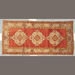 An Oushak carpet West Anatolia Size approximately 4ft 4in x 9ft 2in