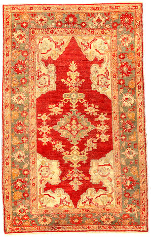 An Oushak rug West Anatolia size approximately 4ft 7in x 7ft