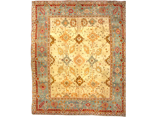 An Oushak carpet West Anatolia size approximately 15ft 4in x 18ft 4in