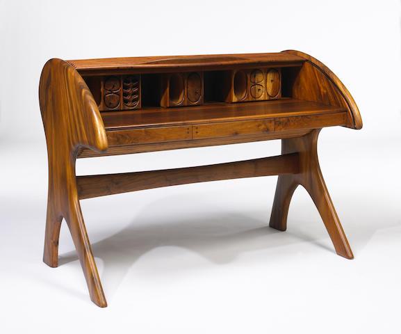 An Arthur Espenet Carpenter Black Walnut Roll Top Desk