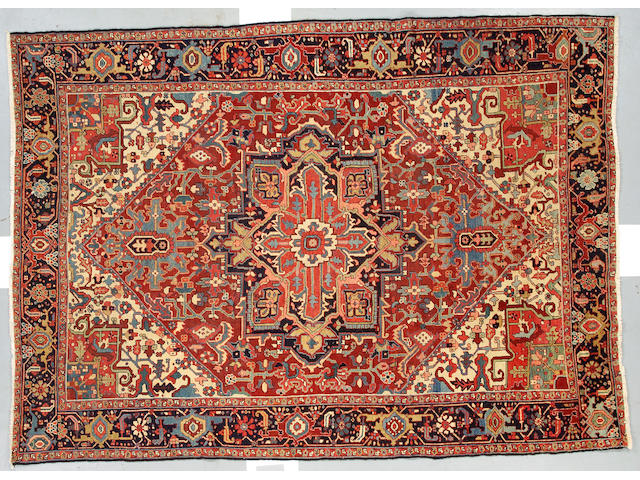 A Heriz Carpet size approximately 10ft 9in x 7ft 10in