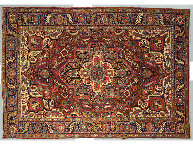 A Heriz Carpet size approximately 9ft 3in x 6ft 4in
