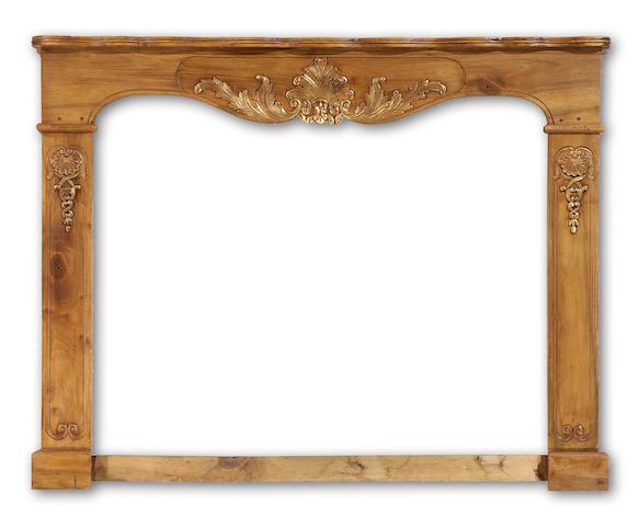 A Louis XV style walnut fireplace surround