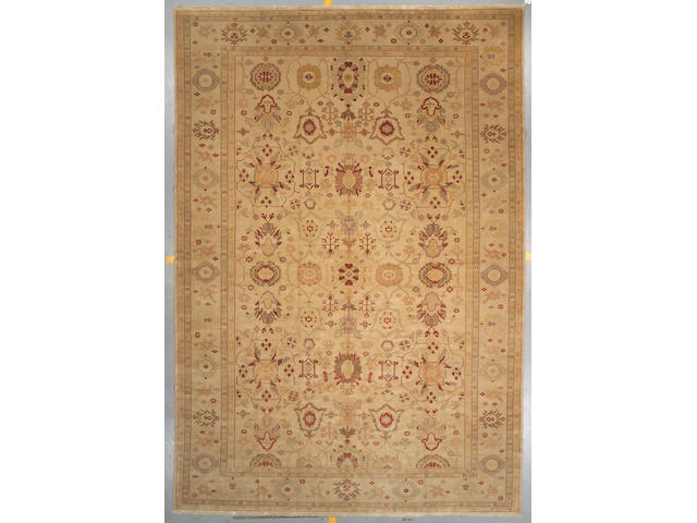 An Indian carpet size approximately 15ft 3in x 10ft 8in