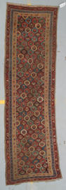 A Kurdish runner size approximately 10ft 4in x 3ft 3in