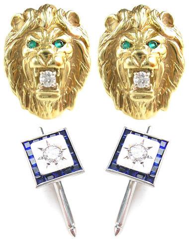 A pair of diamond, emerald, lion head cufflinks with three diamond white gold stars