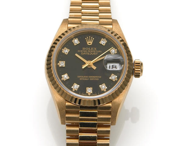Rolex. A Lady's 18k rose gold self-winding calendar bracelet watch with diamond set dialOyster Perpetual Datejust, Ref.69178, circa 1987