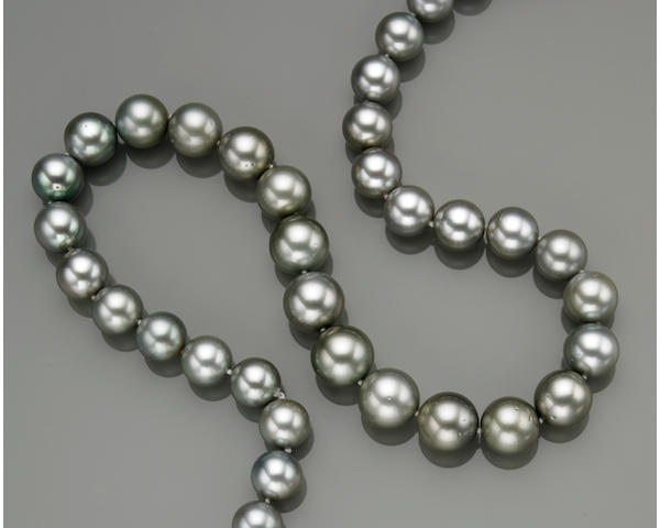 A silver South Sea cultured pearl, diamond and fourteen karat white gold graduated necklace