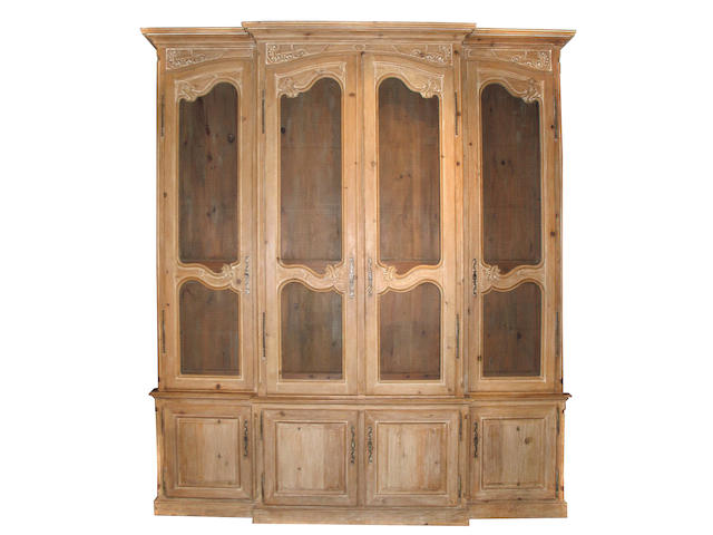 A large Louis XVI style whitewashed pine breakfront cabinet
