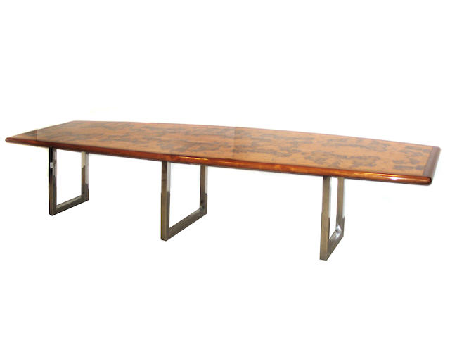 A contemporary burled wood and chromed conference table