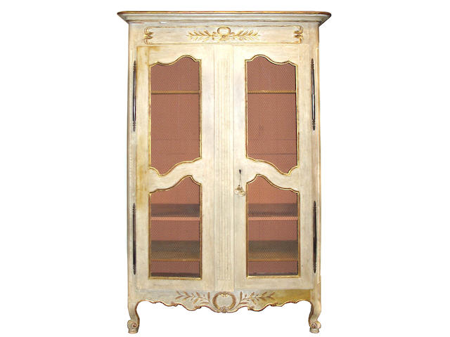 A Louis XV parcel gilt and paint decorated armoire