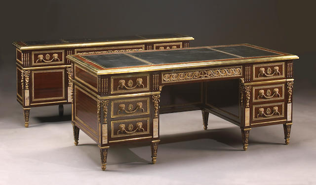 A Louis XVI style gilt bronze mounted writing desk and en suite console