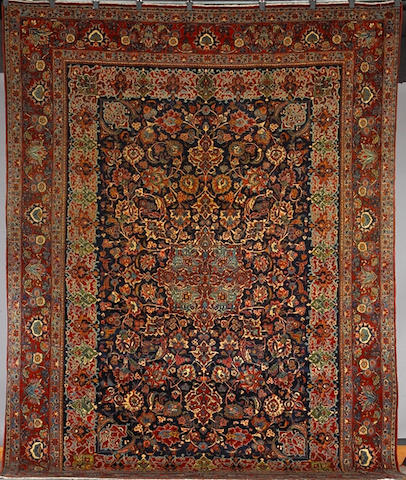 A Kashan carpet size approximately 12ft 2in x 8ft 8in