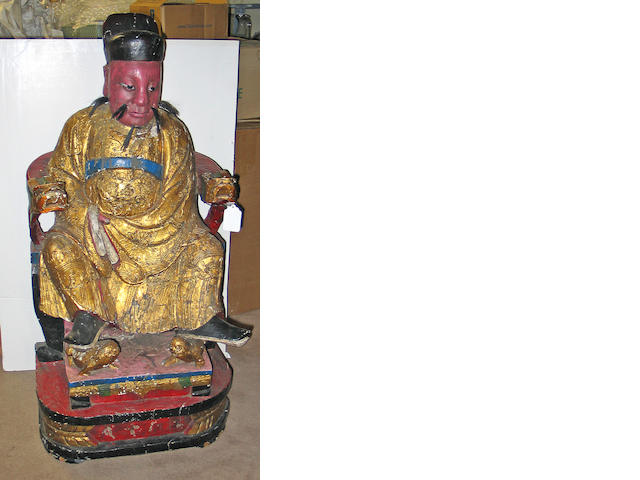 A large polychrome and gilt lacquered carved wood figure of a Daoist deity