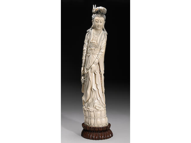 A large tinted ivory figure of Guanyin