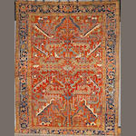 A Heriz carpet size approximately 10ft 10in x 8ft