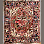 A Heriz rug size approximately 5ft 8in x 4ft 10in