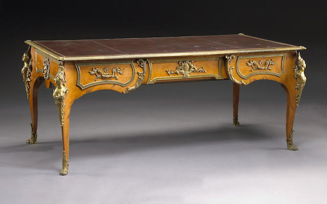 A Louis XV style gilt bronze mounted kingwood bureau plat