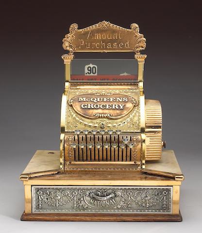 A 'McQueen' cash register 21 x 17 x 16in
