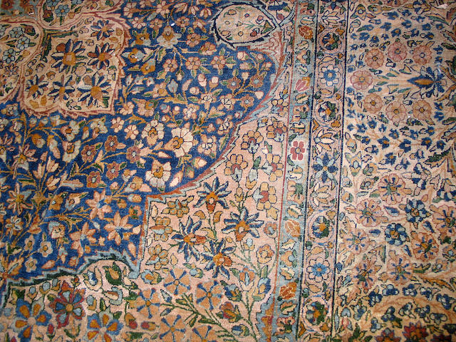 A Kerman carpet size approximately 16ft x 11ft 9in