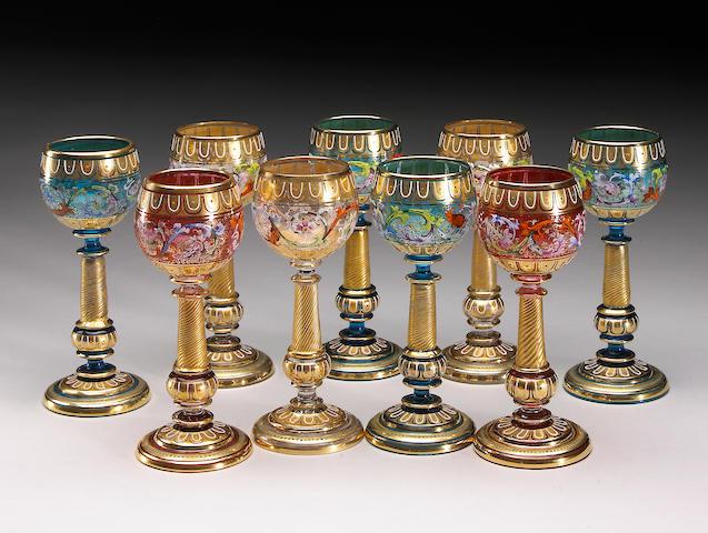 A set of nine Moser gilt and enamel glasses