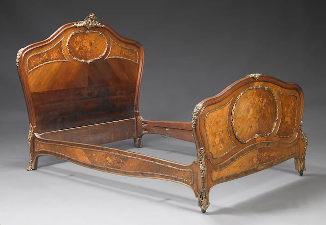 A Louis XV style gilt bronze mounted marquetry bed