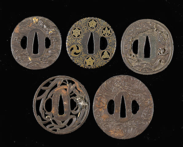 Two mixed metal tsuba, one with brass inlay, one with fly and grass decoration, Edo Period, and thre