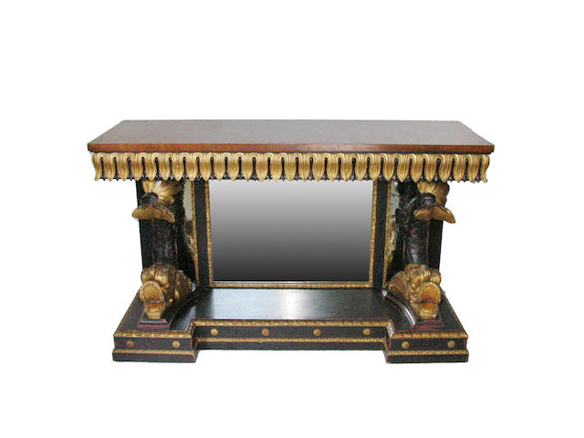 An Empire style parcel gilt and ebonized console table
