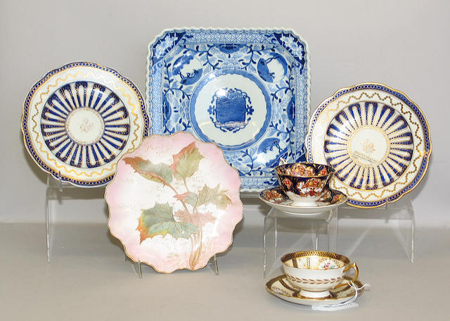 Assembled grouping of ceramics comprising: 5 Caughley cobalt and gilt decorated plates; 6 Doulton dessert plates; 2 English plates decorated in a 'Japan' pattern; 4 various cups and saucers; Limoges partial service decorated with butterflies; English porcelain low dessert comport transfer printed and hand colored in a chinoiserie pattern; 8 Johnson Bros. Blue and white transfer printed bowls, creamer with luster glaze and a Japanese blue white square platter