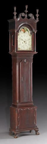A Chippendale carved walnut tall case clock