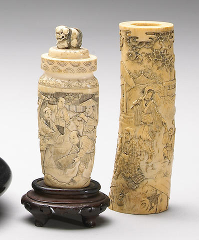 Three carvings, one an ivory tusk section, a covered vase, and a bone shrine