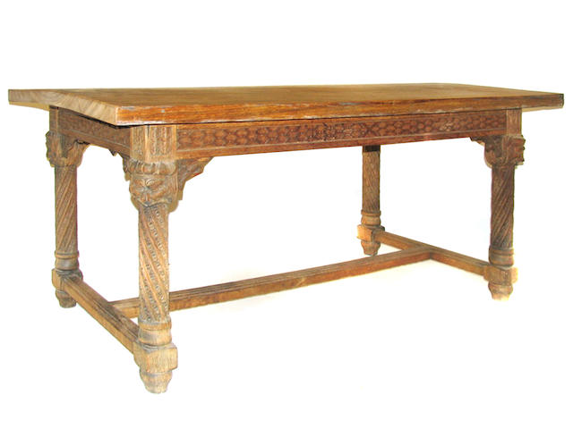 A Continental Baroque style carved oak and walnut center table with single drawer