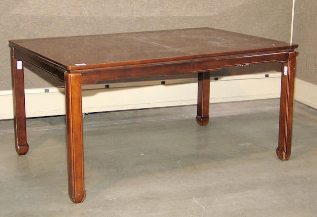 An Asian style mixed hardwood dining table