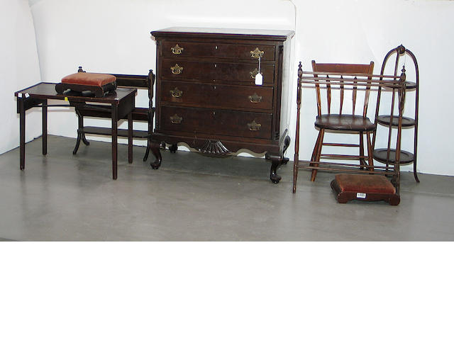 A larg miscellaneous grouping of furniture and decorations comprising two foot stools, a mahogany book rack, a muffiniere, a George II style bookcase, an arrowback chair, a quilt rack, a small occasional table, two machine woven tapestries, two Asian screens, and a chest of drawers