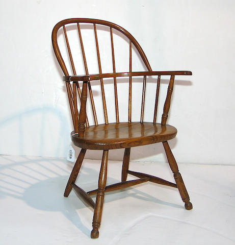 A mixed wood sack back Windsor armchair