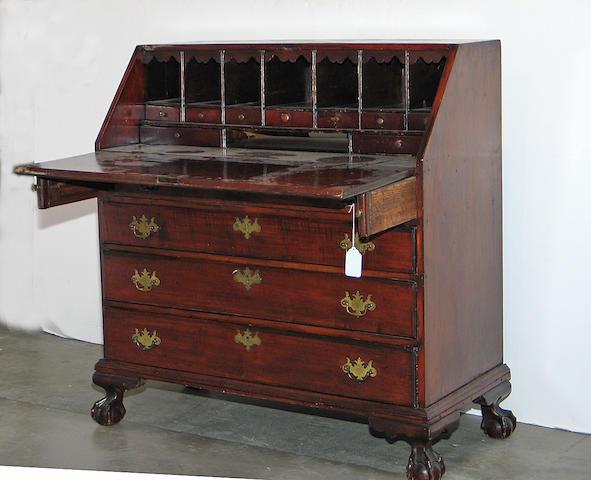 A Chippendale maple slant front desk