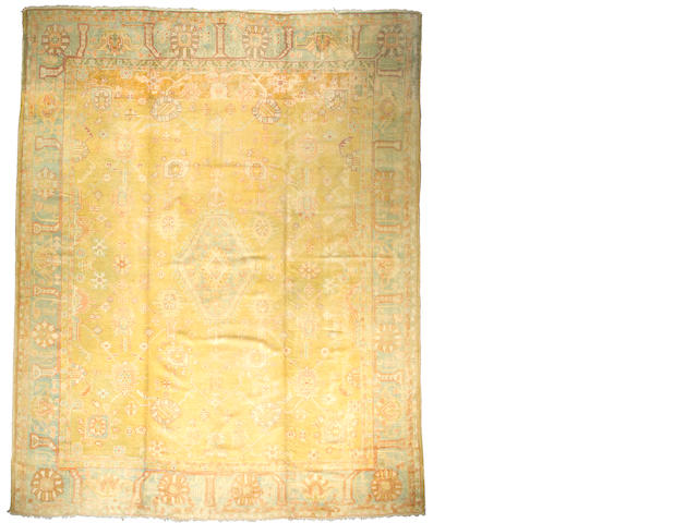 An Oushak carpet West Anatolia size approximately 11ft 6in x 14ft 5in