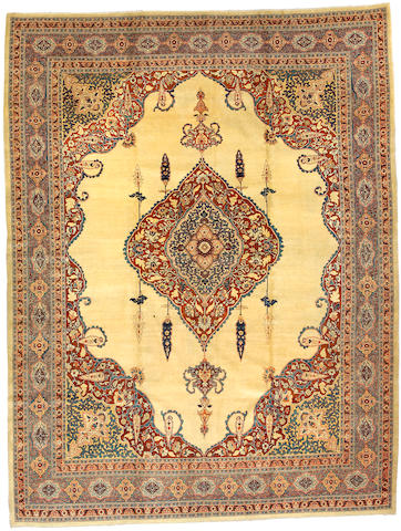 A Tabriz carpet Northwest Persia size approximately 9ft 8in x 12ft 8in